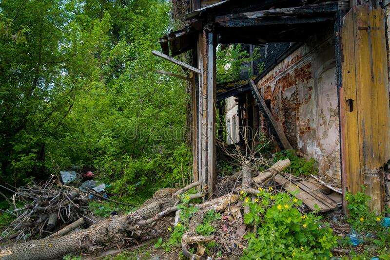 Broken wooden house in rural stock photos