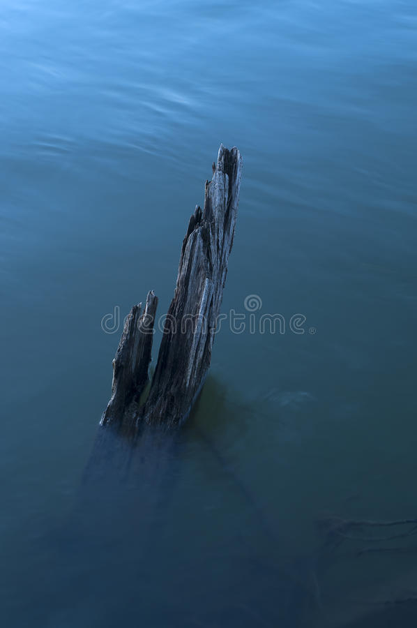 The broken wooden ship. The old broken wooden ship acts from under water stock image