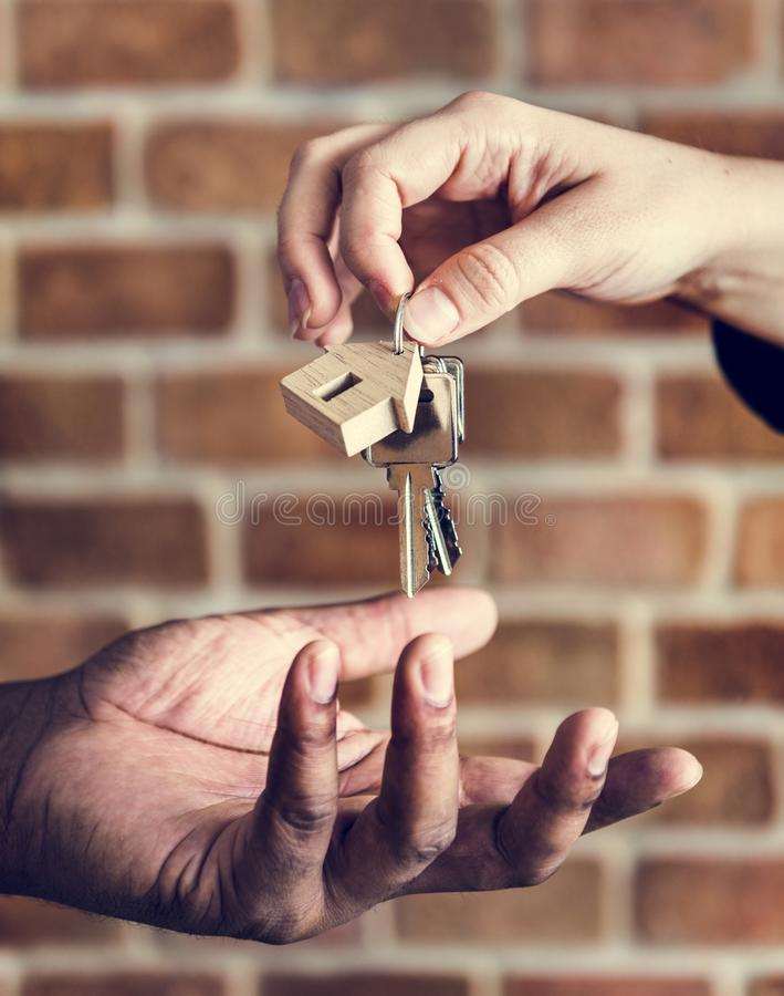 Broker Giving Keys Of New House to Customer stock images