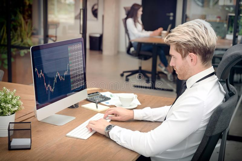 Broker or investor analyzing chart in office. Trading concept with stocks graph on screen stock photo