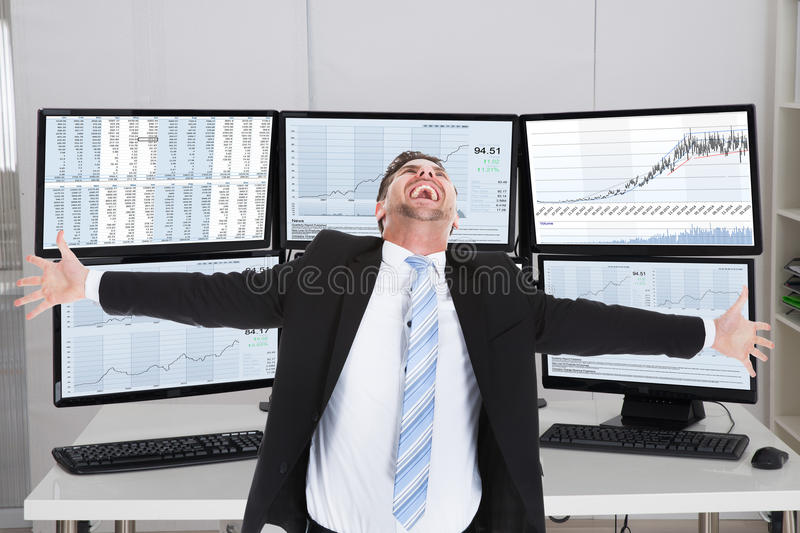 Broker Laughing While Standing With Arms Outstretched stock photo