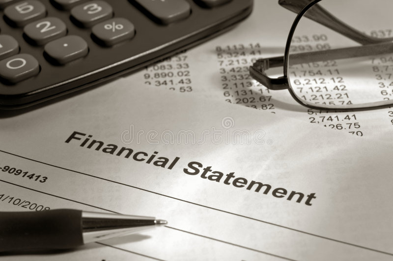 Brokerage Financial Statement with Pen and Glasses royalty free stock photo