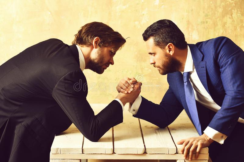 Brokers arm wrestling in office. Business concept, brokers arm wrestling in office royalty free stock image