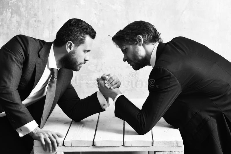 Brokers arm wrestling in office. Business concept, brokers arm wrestling in office royalty free stock photos