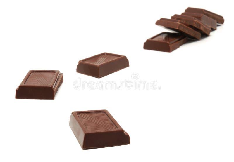 Brokken van chocolade. stock afbeeldingen