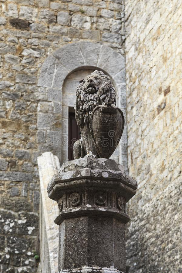 Heraldic lion in a medieval castle. BROLIO CASTLE, ITALY - SEPTEMBER 15, 2018: This is a sculpture of a heraldic lion with a shield with a coat of arms on a stock images