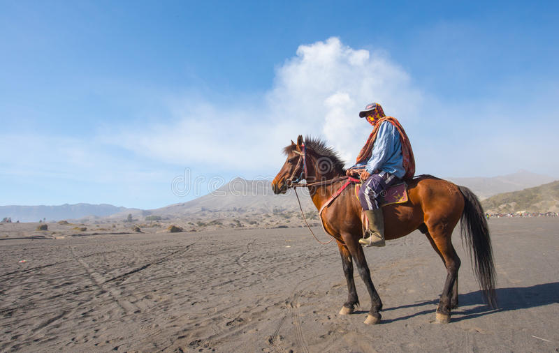 BROMO, INDONESIA - Sep 13: Unidentified workers wait horse rental for tourists at Mount Bromo on Sep 13, 2015 in Java, Indonesia. BROMO, INDONESIA - Sep 13 stock photos