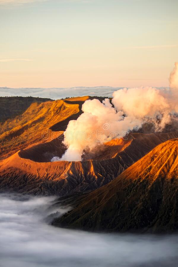 Free Bromo Volcano Crater Erupt Release Smoke With Twilight Sunrise Sky Background And Morning Fog Landscape At Indonesia Bromo Royalty Free Stock Photo - 185633575
