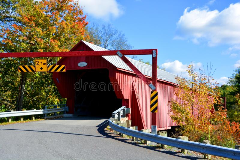 Freeport Covered Bridge. BROMONT QUEBEC CANADA 10 19 2019: Freeport Covered Bridge since 1870 in Cowansville, Quebec over Yamaska River royalty free stock photos