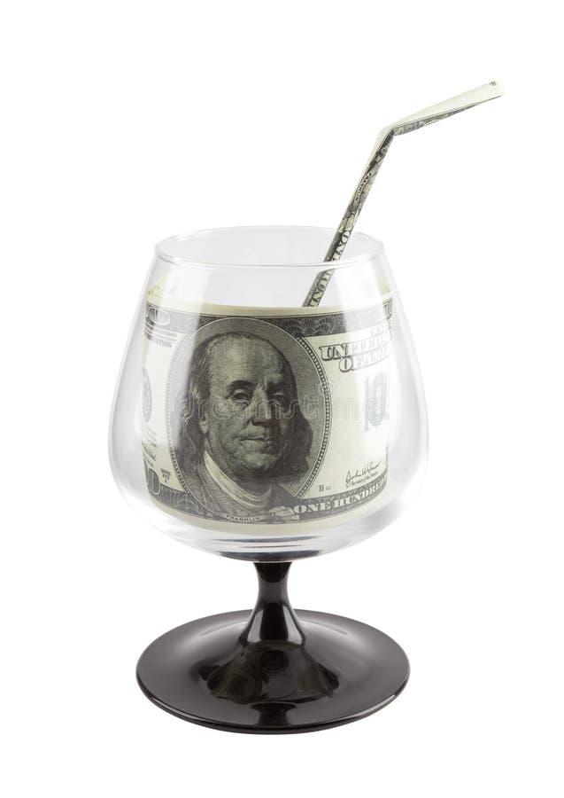 Bron van financiën. De drank van het geld in betaald glas. royalty-vrije stock afbeeldingen