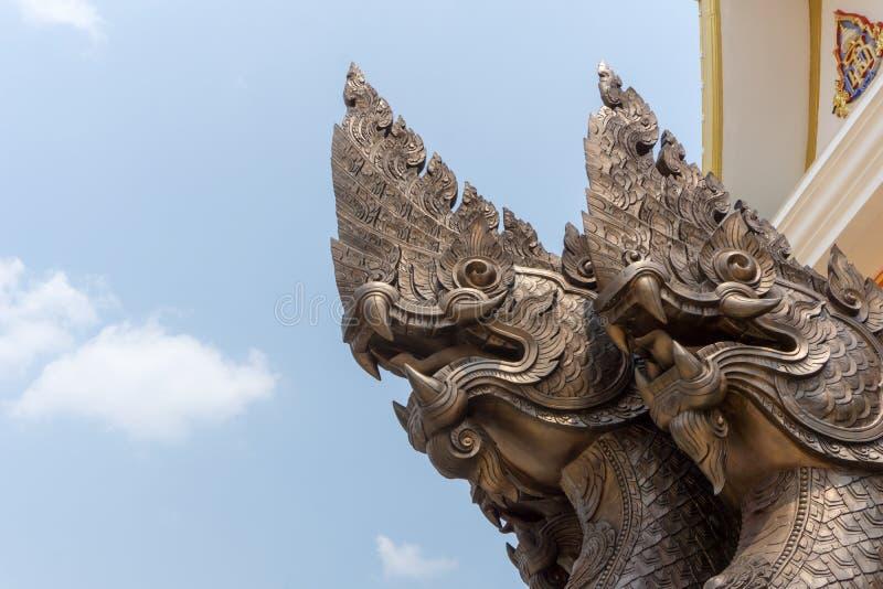 Brons gietende hoofden van naga, een beroemd standbeeld in Boeddhismecultuur royalty-vrije stock afbeelding