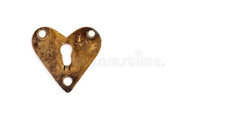 Brons hjärta med nyckelhålet på vit bakgrund Beståndsdel för design för dag för förälskelsesymbolvalentin kopiera avstånd fotografering för bildbyråer