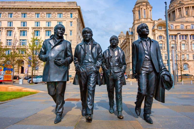 Brons statyn av Beatleset på Merseysiden i Liverpool, UK royaltyfria foton