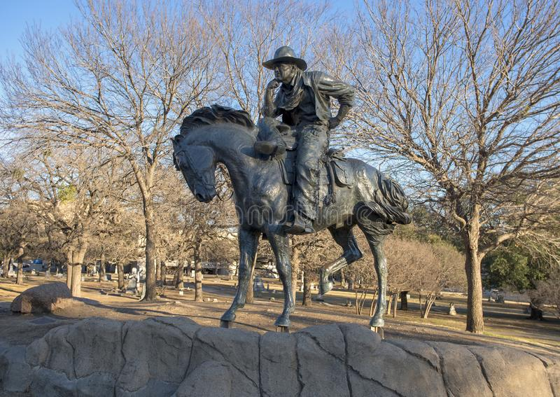 Bronscowboy op horseback in het Pioniersplein, Dallas, Texas stock afbeelding