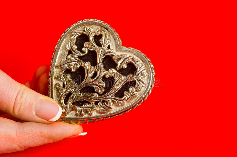 Bronse antique heart in hand