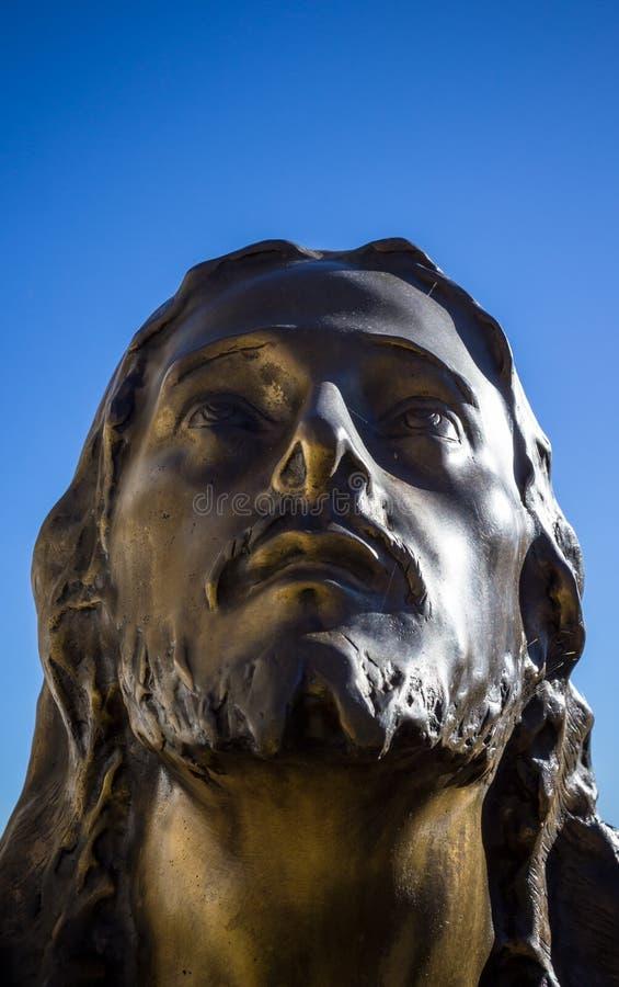 Bronsstandbeeld van Christus stock afbeeldingen