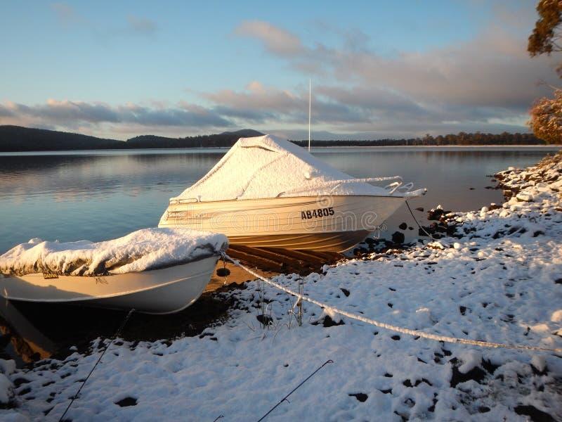 Bronte Lagoon. Snow covered boats on Bronte Lagoon Tasmania stock photography