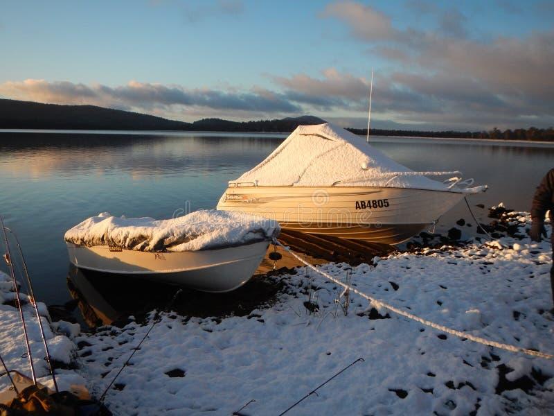 Bronte Lagoon. Snow covered boats on Bronte Lagoon Tasmania stock images