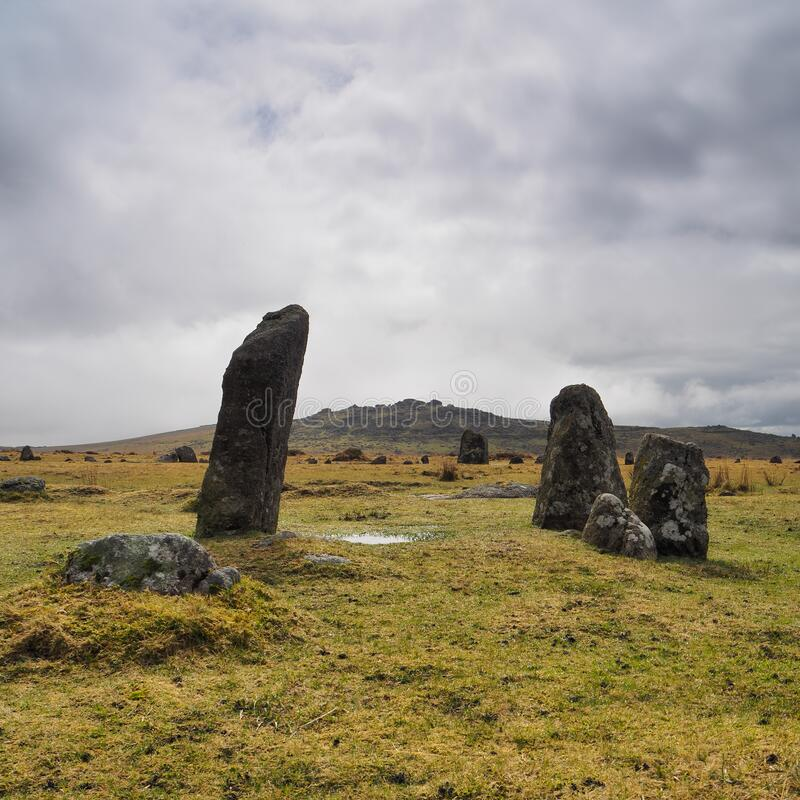 Bronze Age Stone Rows at Merrivale Prehistoric site with Kings Tor in the background, Dartmoor National Park, Devon royalty free stock photos