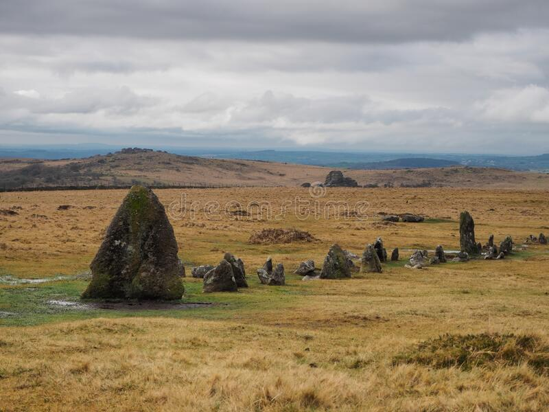 Bronze Age Stone Rows at Merrivale Prehistoric site with Vixen Tor in the background, Dartmoor National Park, Devon royalty free stock images