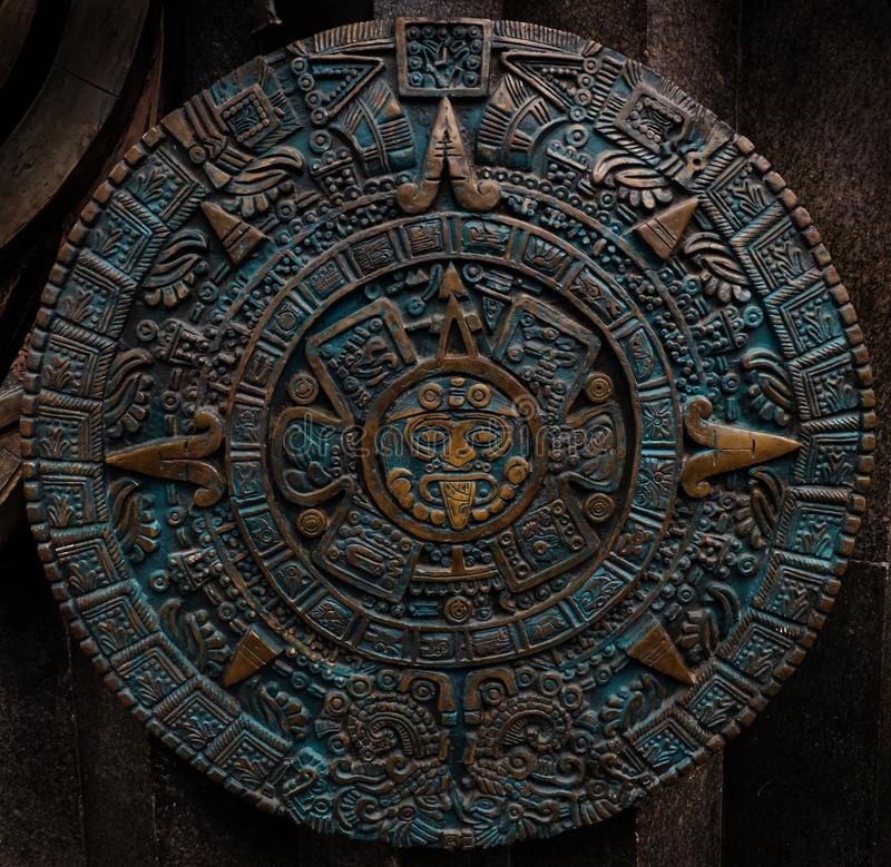 Bronze ancient antique classical Aztec calendar round ornament pattern decoration design background. Aztec abstract texture fracta stock image