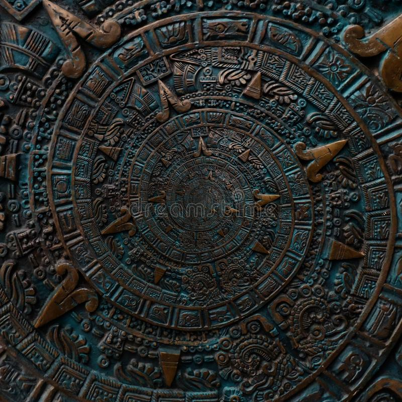 Bronze ancient antique classical spiral aztec ornament pattern decoration design background. Surrealistic abstract texture fractal stock photo