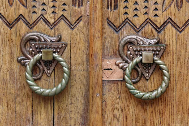 Bronze antique handles. Old oak door and keyhole. royalty free stock photos