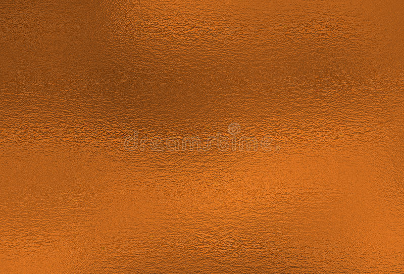 Bronze background. Metal foil decorative texture stock images