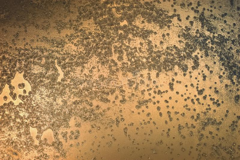 Bronze background with shells and ulcers. Spotted surface stock photos
