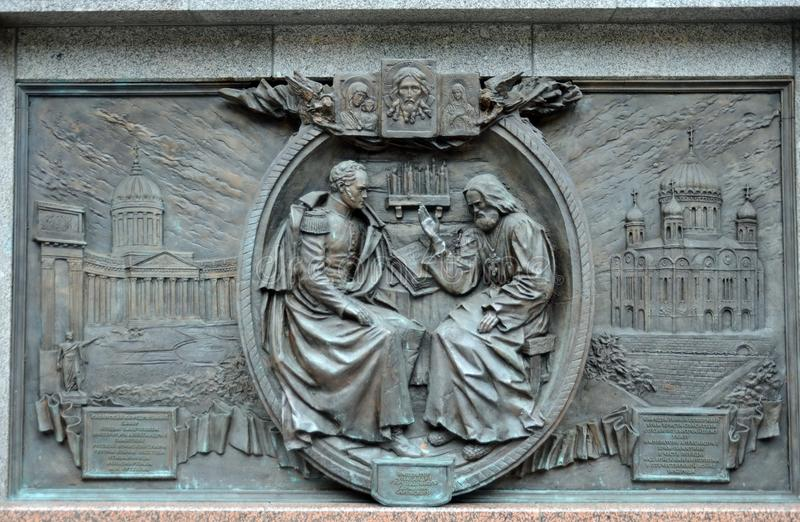 Bronze bas-relief depicting the Battle of Borodino at the monument to Emperor Alexander the First in the Alexander Garden of the M stock photography