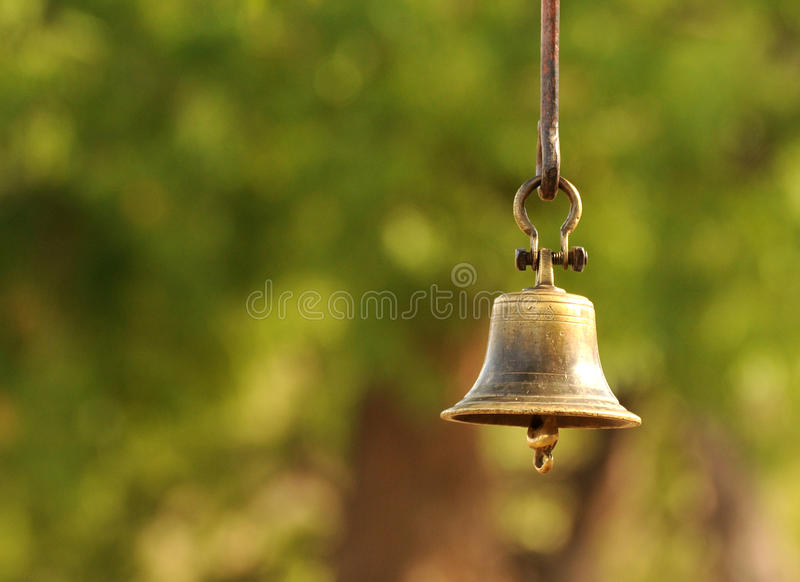 Bronze Bell On Green Stock Images
