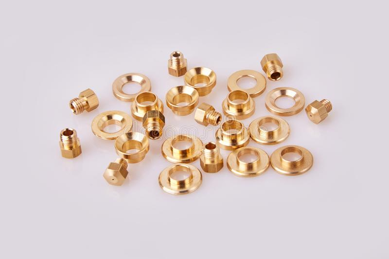 Bronze Brass Flat Washers Hardware Gaskets and GIGLEURs. Close-up, of different sizes scattered a white background. A nozzle jet that is calibrated to stock photography