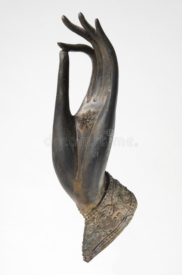 Bronze Buddha Hand. Beautiful antique sculpture of Buddha's hand expressing the mudra of teaching the Dharma stock photos