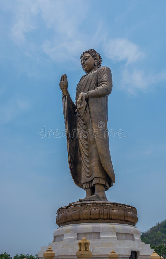 Bronze buddha statue standing scenic in buddhist place.  royalty free stock images