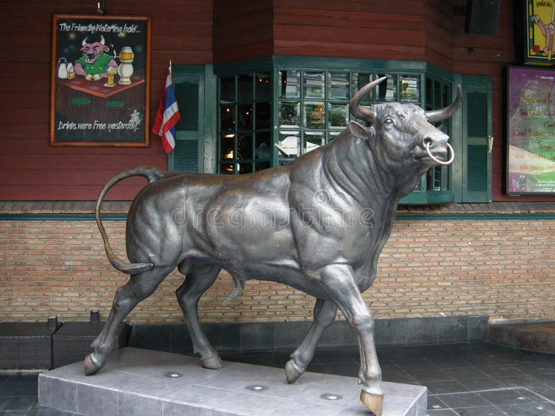 Bronze Bull. Outside a popular pub in a quiet street in Bangkok, Thailand stock images