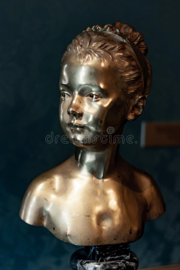 Bronze bust of a little girl. Saint Petersburg, Russia - 7 September 2019. bronze bust of a little girl royalty free stock photos