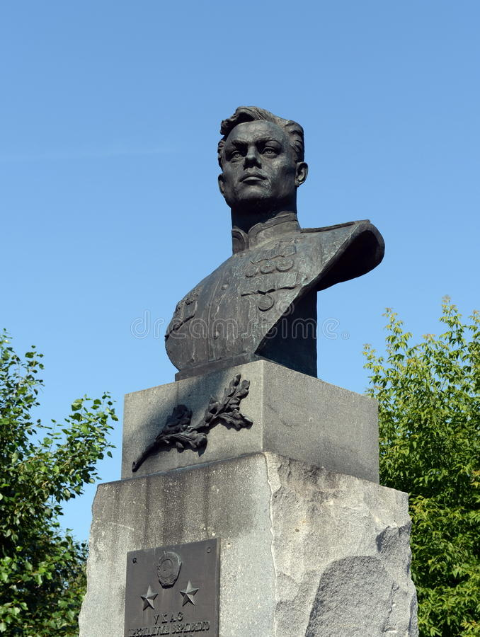 A bronze bust to the military pilot Pavel Plotnikov on Liberty Square in Barnaul. BARNAUL, RUSSIA - JULY 13, 2015:A bronze bust to the military pilot Pavel royalty free stock photo