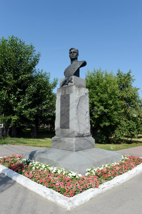 A bronze bust to the military pilot Pavel Plotnikov on Liberty Square in Barnaul. BARNAUL, RUSSIA - JULY 13, 2015:A bronze bust to the military pilot Pavel stock images