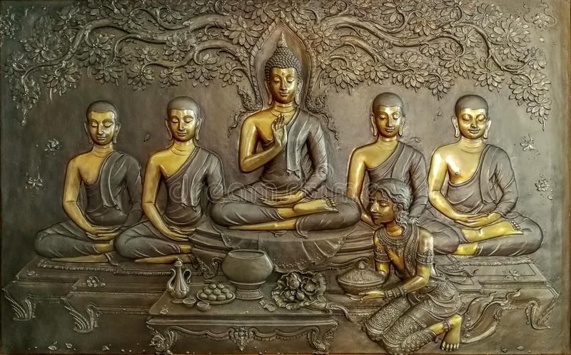 Bronze cast art of Buddha, his disciple followers inside Thailand temple. royalty free stock photo