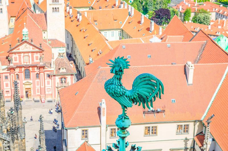 Bronze cock at spire of St. Vitus Cathedral with courtyard square of Prague Castle royalty free stock photo