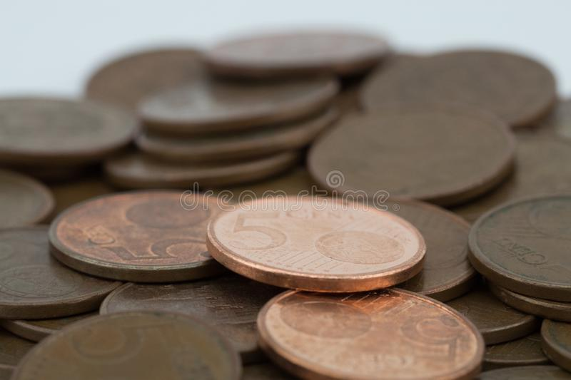 Bronze coins on white background. Coins of five euro cents. Savings.  stock photos
