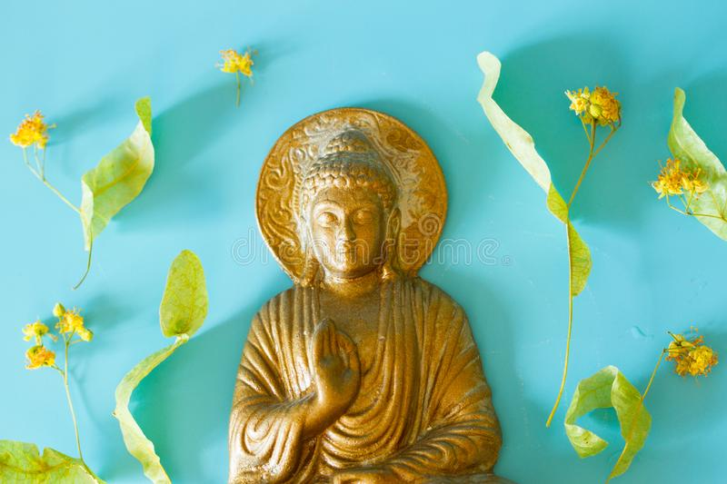 Bronze colored Buddha statuette royalty free stock photography
