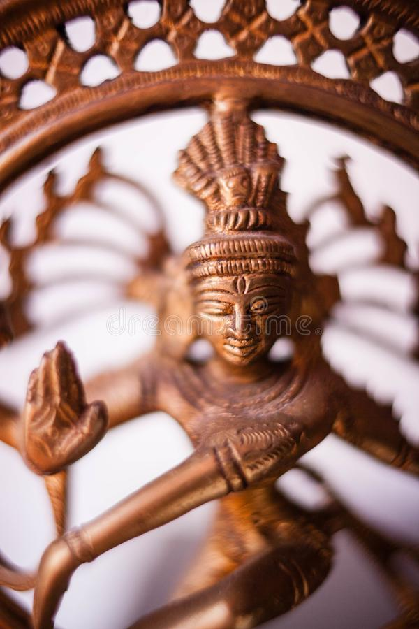 Bronze dancing Shiva. Boke. Bronze dancing Shiva. Toned photo with space for text royalty free stock images