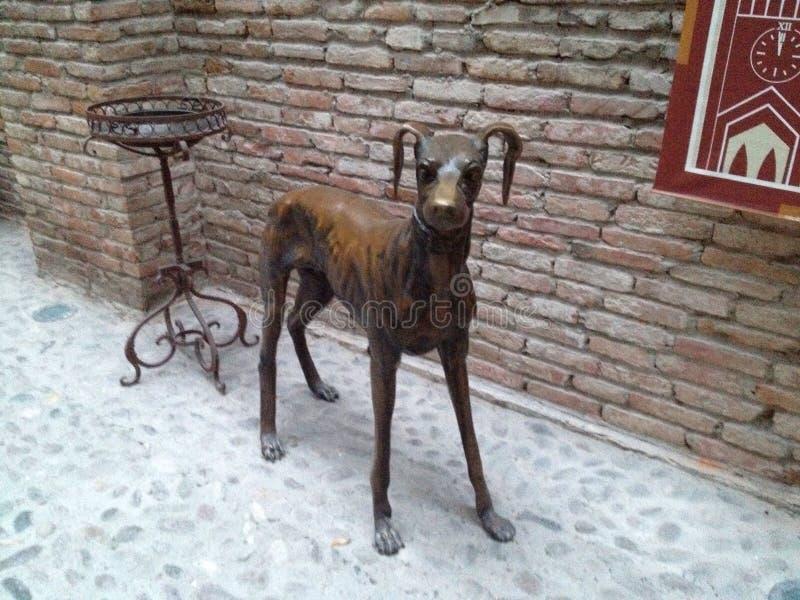 Bronze Dog. In entrance corridor stock photography
