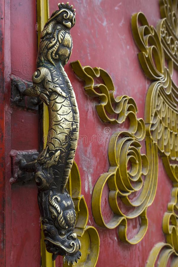 Bronze door handle at Nepalese Temple, Nepal. Vintage brass handle in Nepalese Temple royalty free stock images
