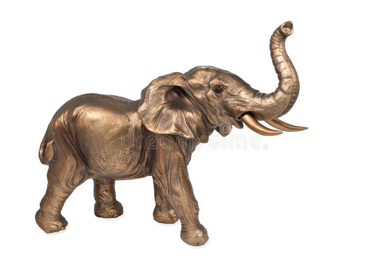 Bronze elephant figurine. With a raised trunk isolated on white background stock image
