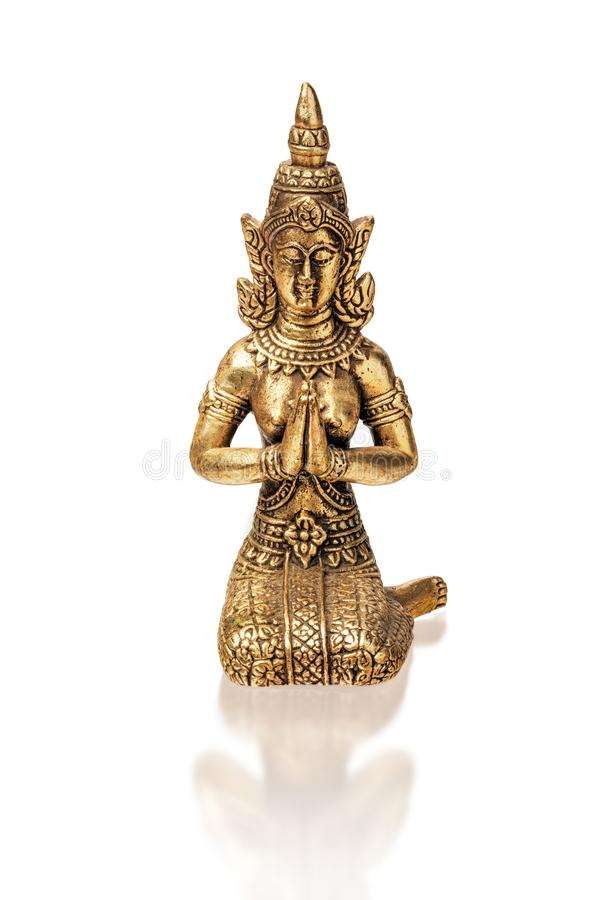 Bronze figure of thai fairy, a traditional Thai Buddhist character. isolate on a white background, close-up royalty free stock photos