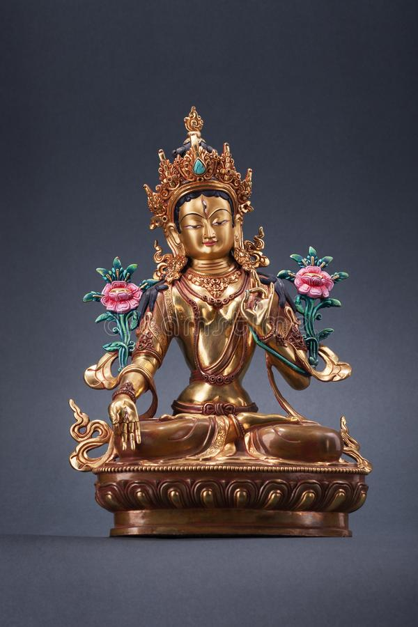 Bronze figurine of a green Tara - the great woman of a bodkhisattva. stock images