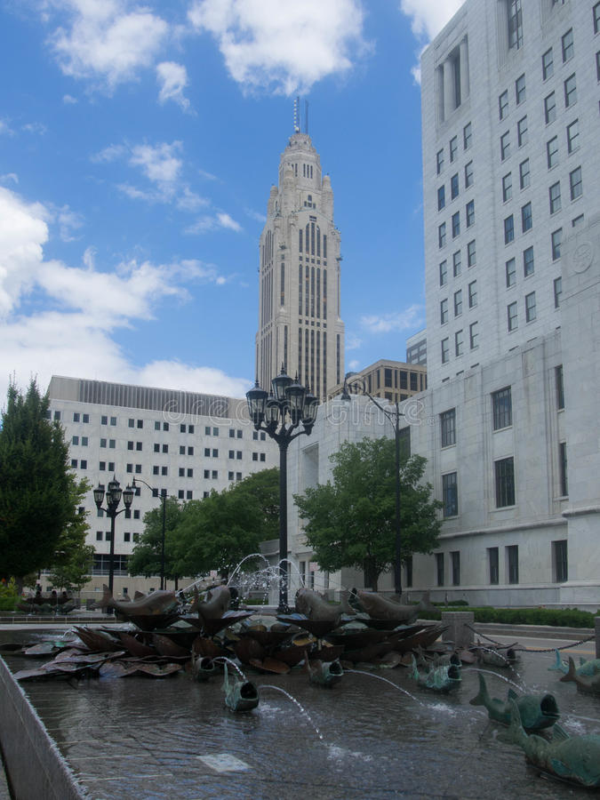 Bronze Fish Fountain. With the Lincoln Leveque in the background in downtown Columbus, Ohio stock photography