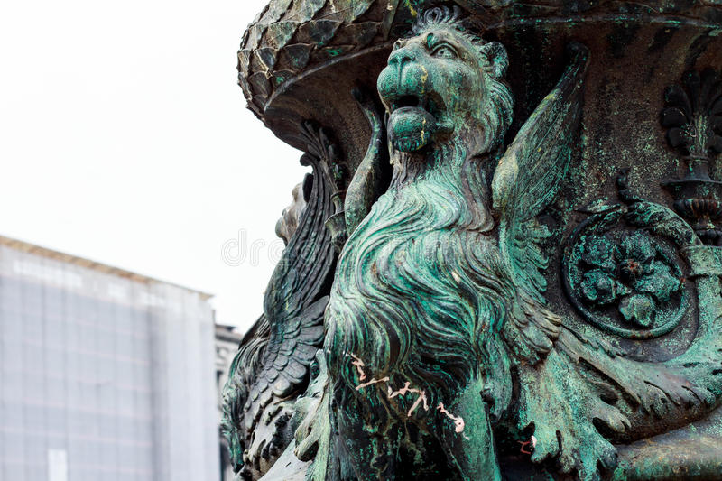 Bronze griffin at the pot in a shiny day stock photos